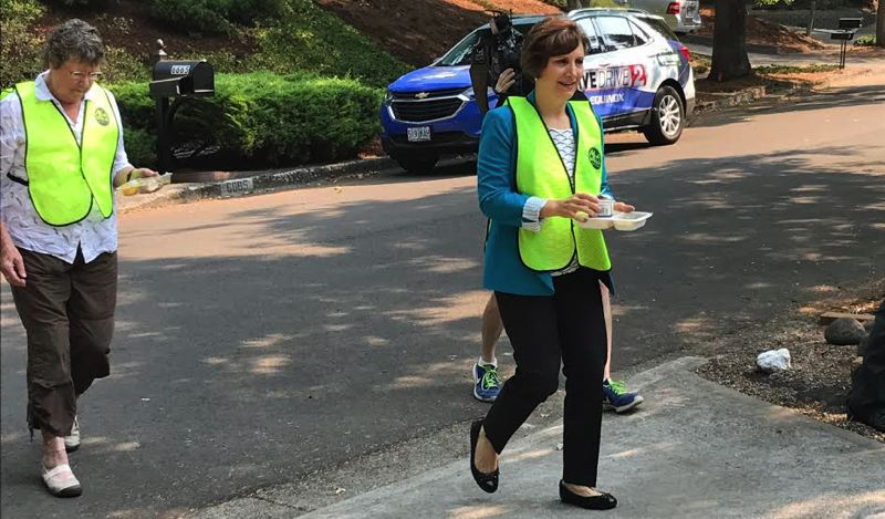 TIMES PHOTO: DANA HAYNES - Congresswoman Bonamici, with Mealson Wheels driver Leta Winston, left, makes the rounds on Tuesday, Aug. 29.