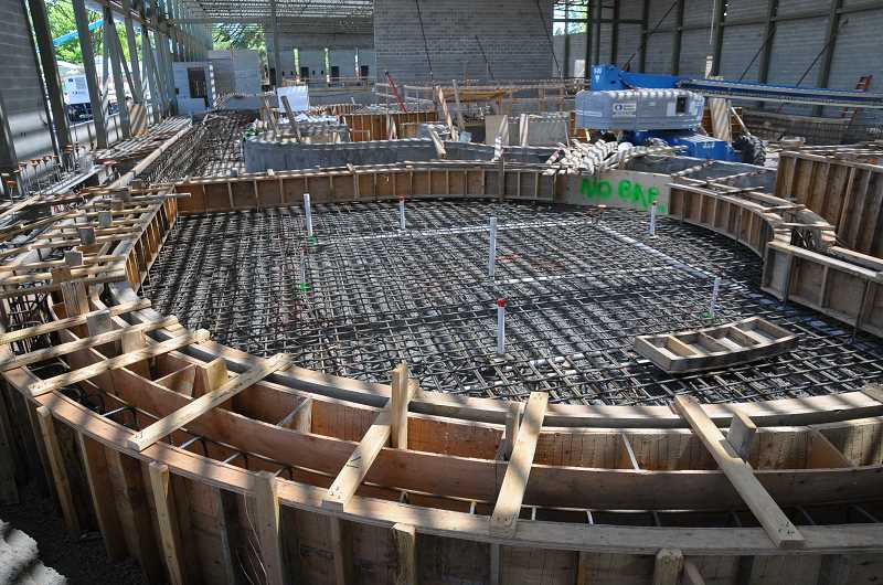 GARY ALLEN - Construction on the new aquatic center forges on unabated as plans for renovation of the old pool facility are being considered.