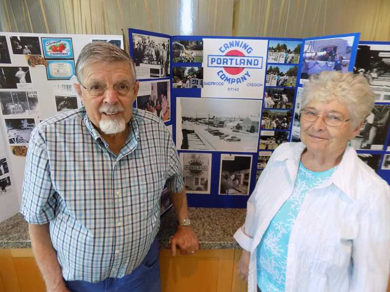 GAZETTE PHOTO: RAY PITZ - Don and Yvonne Scheller stand in front of several displays commemorating the glory days of Portland Canning Company, which once was Sherwood's largest employer before shutting down in 1972.