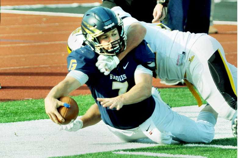 GRAPHIC FILE PHOTO - Fifth-year senior Grant Schroeder enters his fourth year as George Fox's starting quarterback, as the Bruins look to improve on last season's third-place finish in the Northwest Conference.