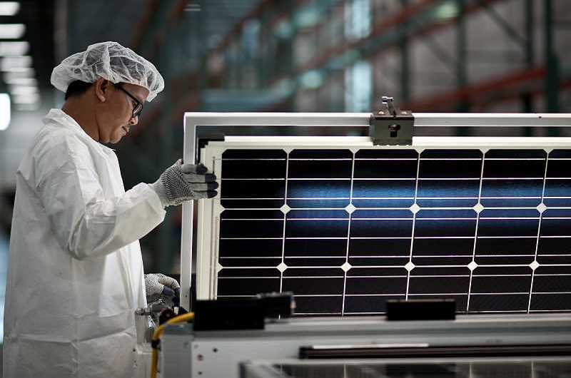 HILLSBORO TRIBUNE FILE PHOTO - A worker inspects a solar panel in 2016 at SolarWorld.