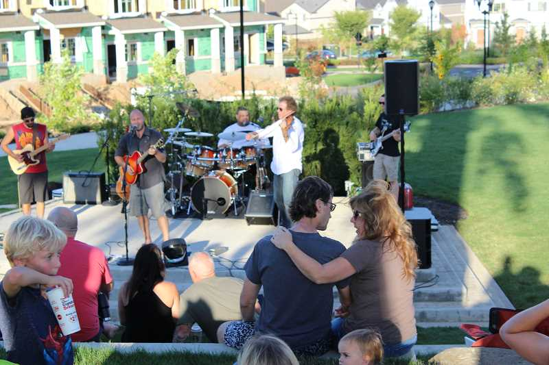 SPOKESMAN PHOTO: ANDREW KILSTROM - Residents take a moment to appreciate good weather and better music Tuesday, Aug. 22.