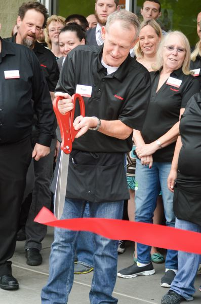 POST PHOTO: CLARA HOWELL - A crowd gathered in the front of Fred Meyer while Roger Wecker, who has been a Fred Meyer employee for 43 years, cut the ribbon at the grand opening of the remodel.