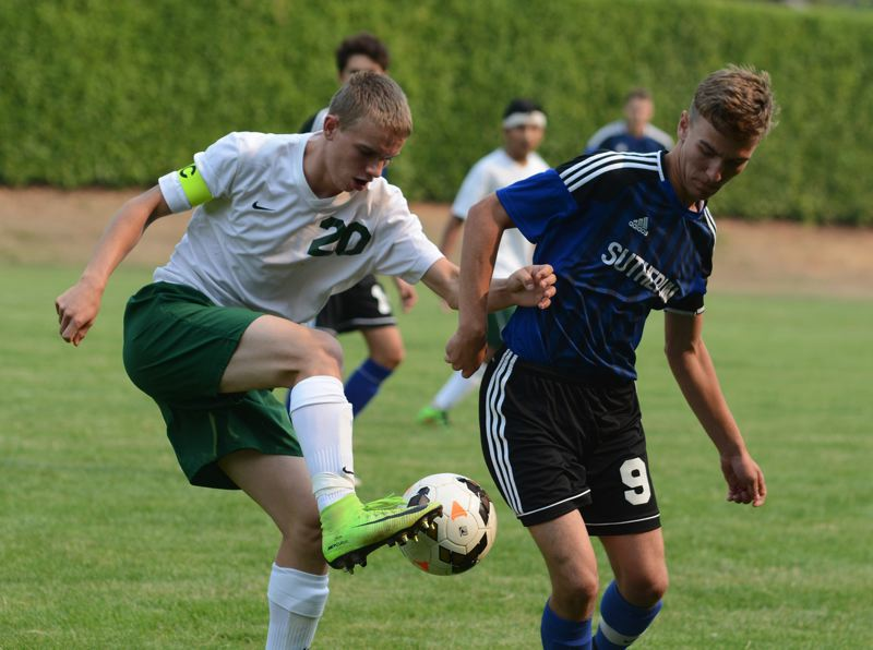 ESTACADA NEWS: DAVID BALL - Estacadas Caleb Brotnov works to win a ball along the sideline against Sutherlins Bryce Olsen during the Rangers 7-2 win Tuesday.
