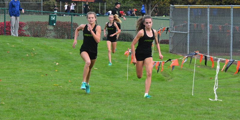 TIMES FILE PHOTO - Jesuit cross country runners Alexis Kebbe, Makenna Schumacher and Libby Rinck are back for the defending Metro League and Class 6A state champions.