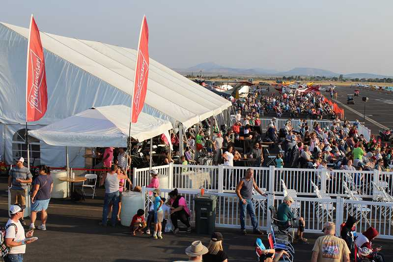 HOLLY M. GILL - The crowd at the Airshow of the Cascades prepares for the Friday night performances. An estimated 14,000 people attended this year's event at the Madras Municipal Airport.
