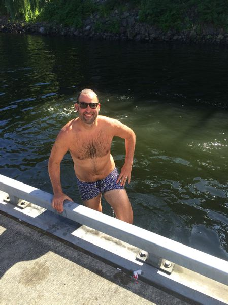 COURTESY: HUMAN ACCESS PROJECT  - Willie Levenson enjoys a swim in the Willamette River. He's one of 150 people who have participated with the River Huggers this summer. They swim downtown in the early mornings and after work.