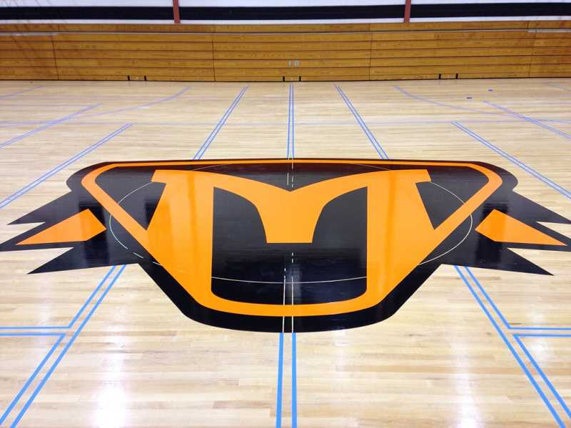 COURTESY PHOTO - Pictured is the new Molalla Indians logo in the center of the high school gym floor.