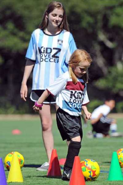 SUBMITTED PHOTO - Kids ages 2-10 learn to love the game of soccer from Kidz Love Soccer, offered through West Linn Parks & Rec. Sign up now.