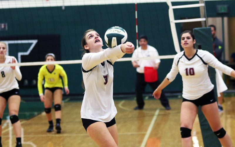 DAN BROOD - Sherwood High School senior Maddy Carbo, shown here in a Three Rivers League match from 2016, returns at setter for the Lady Bowmen this season.