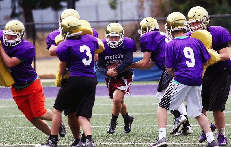 DAN BROOD - First-year player Luke Klein (with ball) could play a number of different positions for the Horizon Christian High School football team this season.