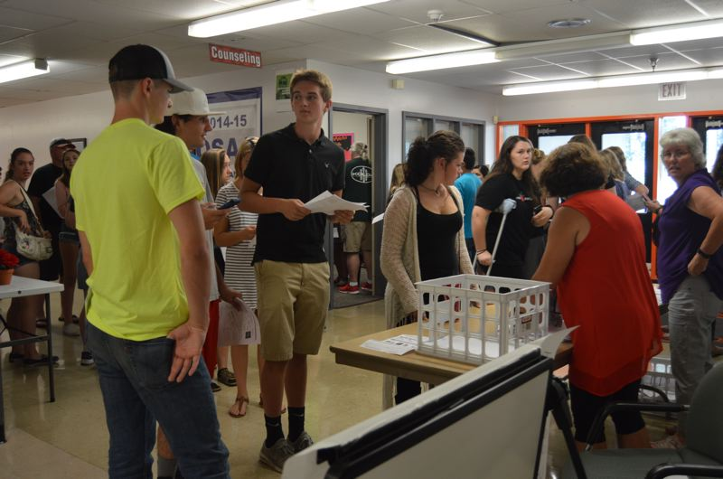 SPOTLIGHT PHOTO: NICOLE THILL - Students at Scappoose High School register for classes Tuesday, Aug. 29, while parents and teens fill the hallways familiarizing themselves with their classes and lockers. Students go back to school next week, after Labor Day.