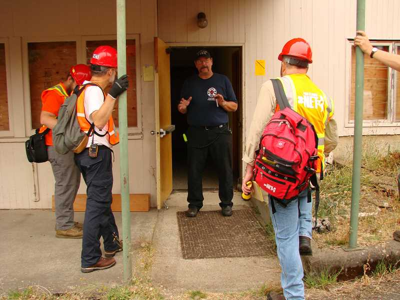 SUBMITTED PHOTO: DONNA HERRON - Portland Fire Bureau Station 18 Captain Gerard Pahissa teaches skills to search and rescue training participants.