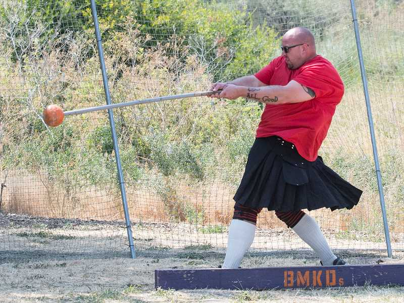 LON AUSTIN/CENTRAL OREGONIAN - Prineville resident Dan Moore throws the hammer during last Saturday's Highland Games. The games, which were held at Crooked River Park, brought some of the biggest and strongest competitors in the northwest to Prineville.