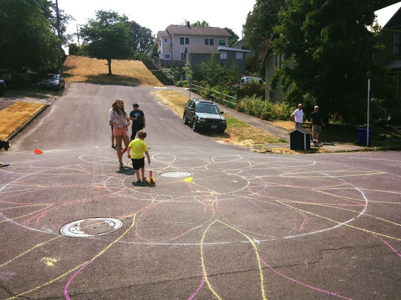 SUBMITTED PHOTO - Members of Oregon City Girl Scout Troop 45064 chalked out the design for the Latourette Park intersection last month.