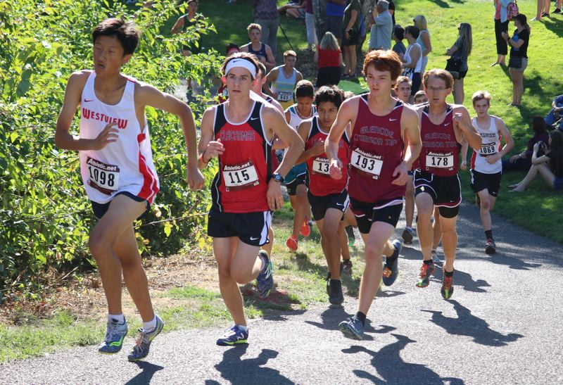 REVIEW/NEWS PHOTO: JIM BESEDA - Clackamas' Jacob Debler (115) covered the 5k course at Rood Bridge Park in 19:01.77 Thursday.