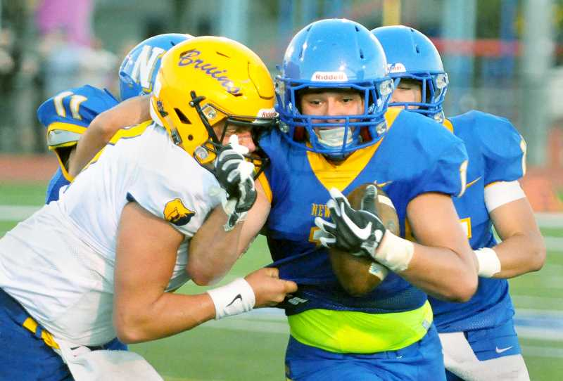 GARY ALLEN - NHS runningback Cam Sutton attempts to shed a Barlow defender during the Tigers 38-21 win over the Bruins Friday night in Newberg