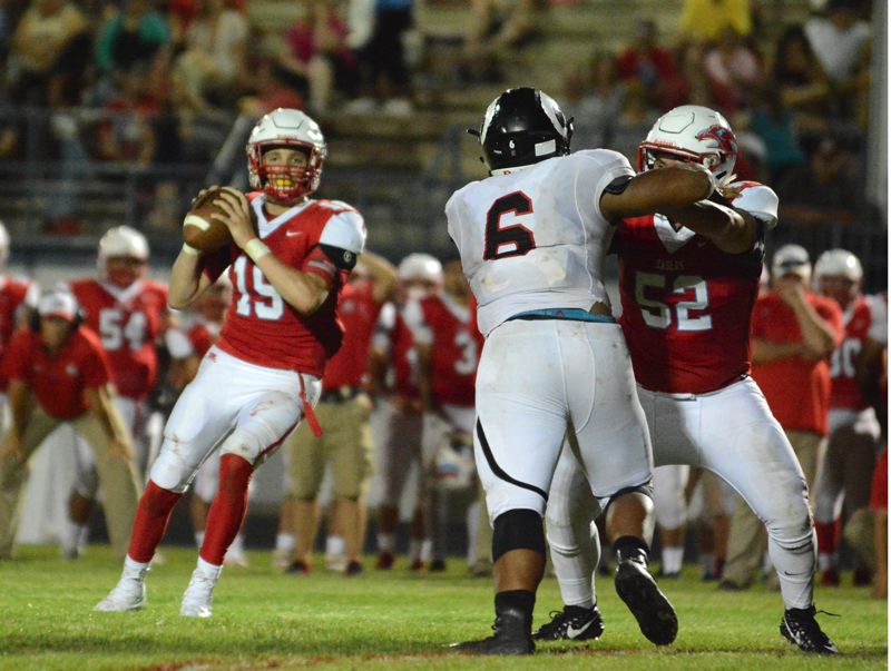 OUTLOOK PHOTO: DAVID BALL - Centennial QB Kaiden Lansford gets ready to fire the winning touchdown pass — an 18-yard fourth-down strike to Dillon Hart — in the Eagles 14-12 win over Radford, Hawaii.