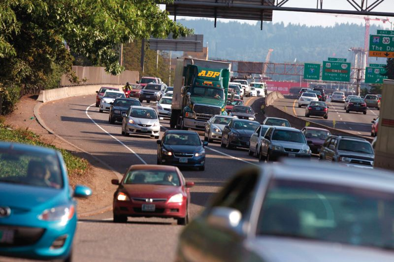 PORTLAND TRIBUNE FILE PHOTO - A recent ODOT report attributed hours of delays to I-5 bottlenecks, but critics say new lanes draw new traffic.