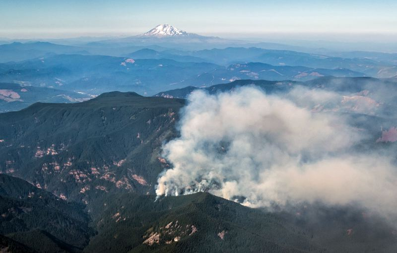TIMES PHOTO: JONATHAN HOUSE - The Eagle Creek fire, seen from the air, grew quickly over the weekend and trapped several groups of hikers.