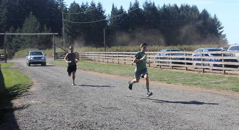 COURTESY PHOTO: PUDDING RIVER RANCH - This is the second year that the Pudding River Ranch has held a fundraising 5K run and farm party that's open to the public. Pictured are runners in last year's race, which trails through the farm owned by the descendants of Hubbard hero Marion E. Carl.