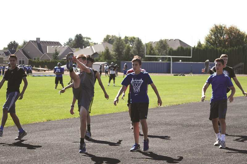 PHIL HAWKINS - The Woodburn boys cross country team brings back four of its top five runners from last season and is looking to make a second consecutive trip to the 5A state championships in November.