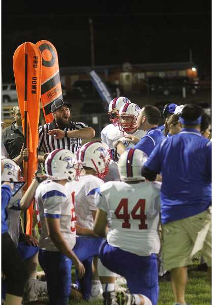 WILL DENNER/MADRAS PIONEER - Madras drew a pair of unsportsmanlike penalties between the third and fourth quarters when a sideline official told players to move out of the way of the chain crew. The official threw his flag a few seconds later, and after a Madras assistant protested, which drew another penalty, head coach Kurt Taylor (second from right) was ejected.