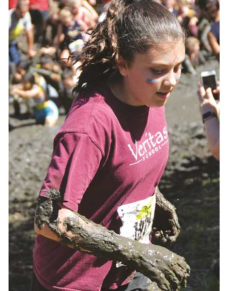 Maddie Huwe emerges from the mud pit at the Ultimook Race Nike Invitational race Saturday in Tillamook. Huwe placed 9th to help the Veritas girls place 13th as a team.