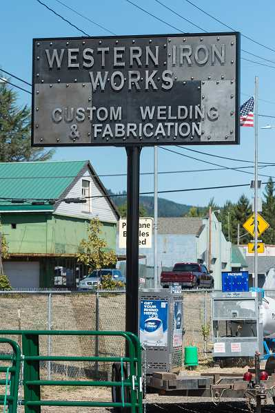 NEWS-TIMES PHOTO: CHRISTOPHER OERTELL - Brady Sheets has occupied the old Gaston Feed space since June but just put up the new sign a few weeks ago.