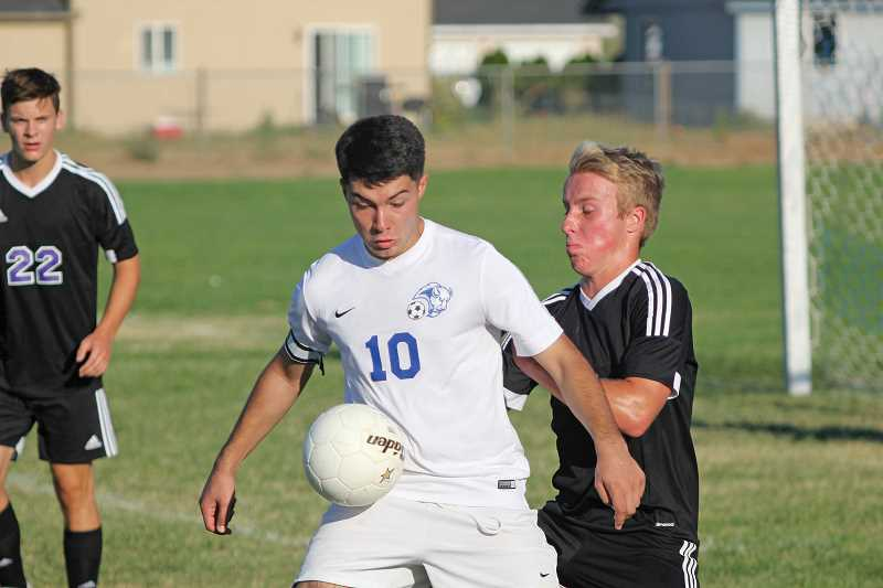 WILL DENNER/MADRAS PIONEER - Madras junior Andres Acuna (10) scored two of the Buffs' three goals in a 3-1 win over Ridgeview last Thursday. He scored his first on a penalty kick and later, was on the receiving end of a Mellie Olivera cross into the center box that Acuna received and put into the net.