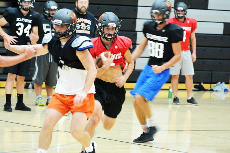 SPOTLIGHT PHOTO: JAKE MCNEAL - Foreground, from left, Indians senior running back Jimmy Jones, senior quarterback Jerad Toman and junior defensive lineman Gavin Larson (88) are eager to avenge last year's loss at St. Helens in the Seven-Mile War scheduled for 7 p.m. Friday in Scappoose.