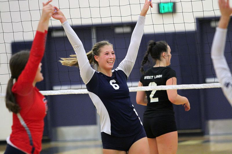 REVIEW PHOTO: MILES VANCE - Lake Oswego's Jensen Kaelin celebrates a point with her team during its five-set loss to West Linn at Lake Oswego High School on Tuesday.
