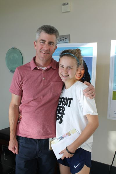 SPOKESMAN PHOTO: CLAIRE GREEN - Joel Dunn and his seventh grader daughter, Fiona, at the Providence playSmart Youth Heart Screening event in Wilsonville Aug. 31.