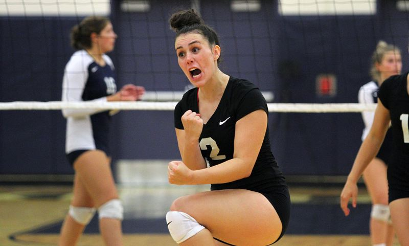 TIDINGS PHOTO: MILES VANCE - West Linn junior setter Hannah Hashbarger celebrates a point during her team's five-set win over Lake Oswego at Lake Oswego High School on Tuesday.