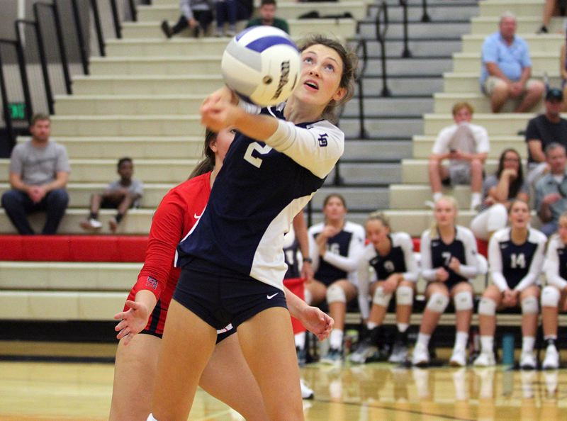 REVIEW PHOTO: MILES VANCE - Lake Oswego's Libby Elmes passes the ball during her team's five-set loss to West Linn at Lake Oswego High School on Tuesday.