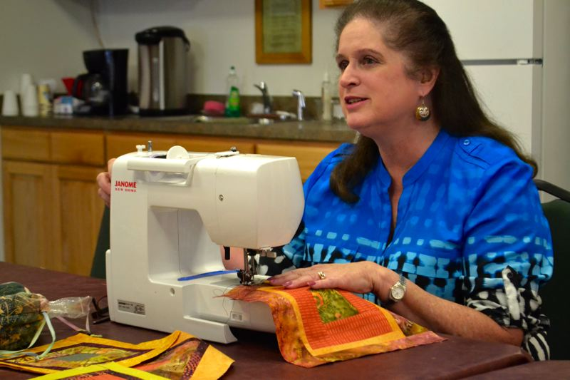 POST PHOTO: BRITTANY ALLEN - Pat Sharp has sewn for 40 years.