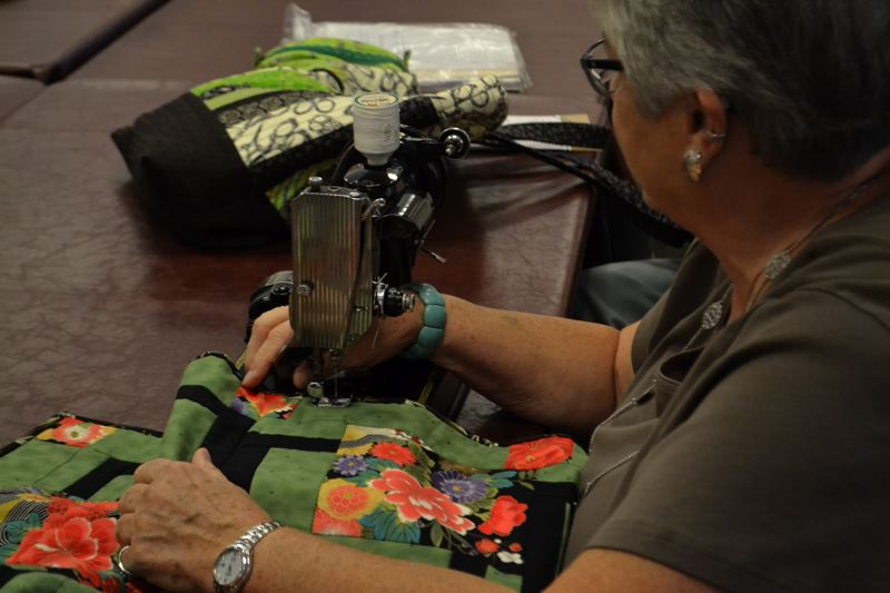 POST PHOTO: BRITTANY ALLEN - Susan Burdell learned of the Sandy Quilting and Fiber Arts Club from a quilt hanging in an area business and joined soon after.