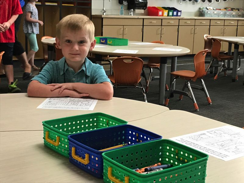 TIMES PHOTO: DANA HAYNES - Jake Scamahorn stakes out his seat for Day 1 of teacher Katie Rice's first-grade class.