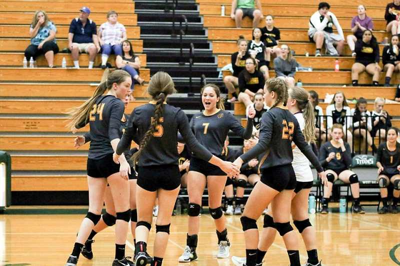 VICKI VANLOO PHOTOGRAPHY - The Forest Grove Viking volleyball team celebrates a point during a game last week.
