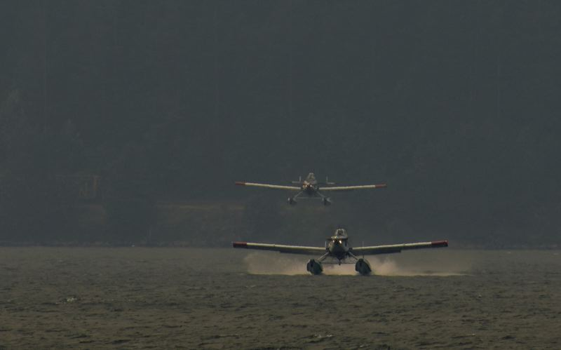 PHOTO COURTESY OF MARK SEGULJIC - Firefighting planes scoop up water from the Columbia River to battle the Eagle Creek blaze.