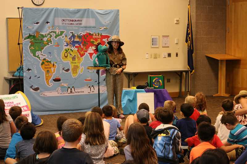 COURTESY: BEAVERTON CITY LIBRARY - Ventriloquist Vicki Gasko Green performed at the Beaverton City Library this summer as part of the library's summer reading program. Other Washington County libraries held similar events.