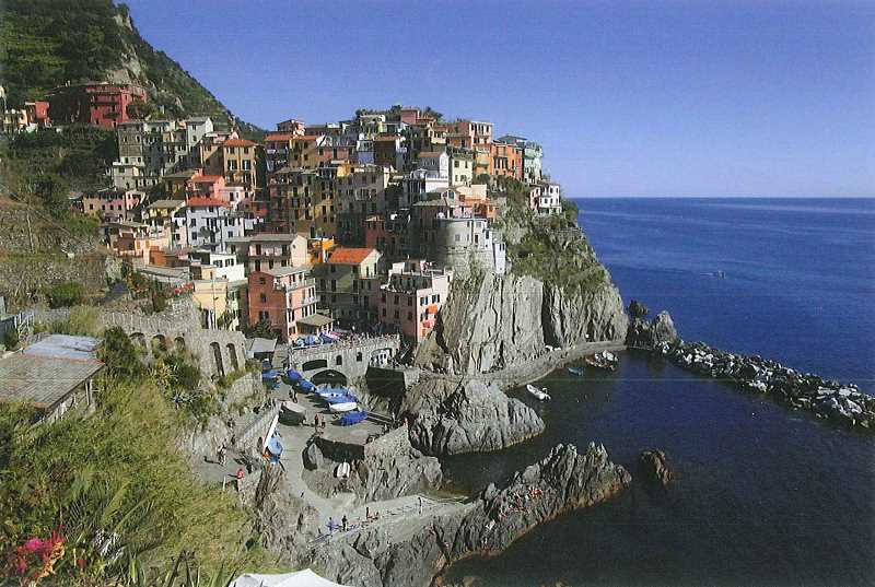 PHOTO BY SUSAN MATHENY - The village of Manarola is perched on a cliff above the Ligurian Sea.