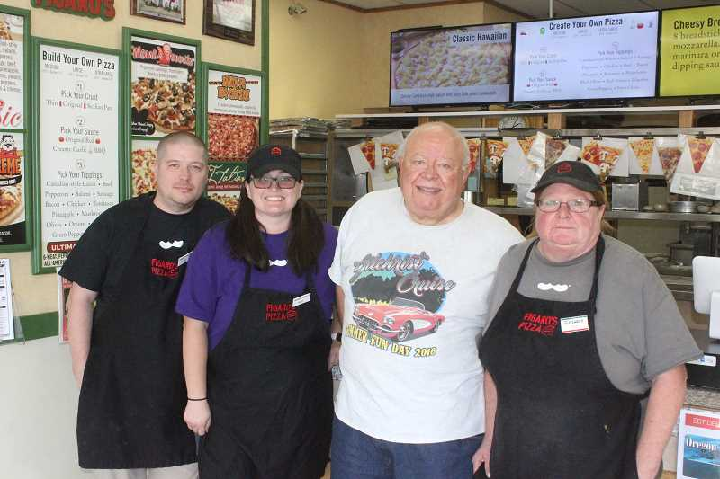 SUSAN MATHENY/MADRAS PIONEER - New owners Dan and Shaye Branson, at left, pose with retiring owner Tom Hansen, center, and store manager Sue Shockey, right.