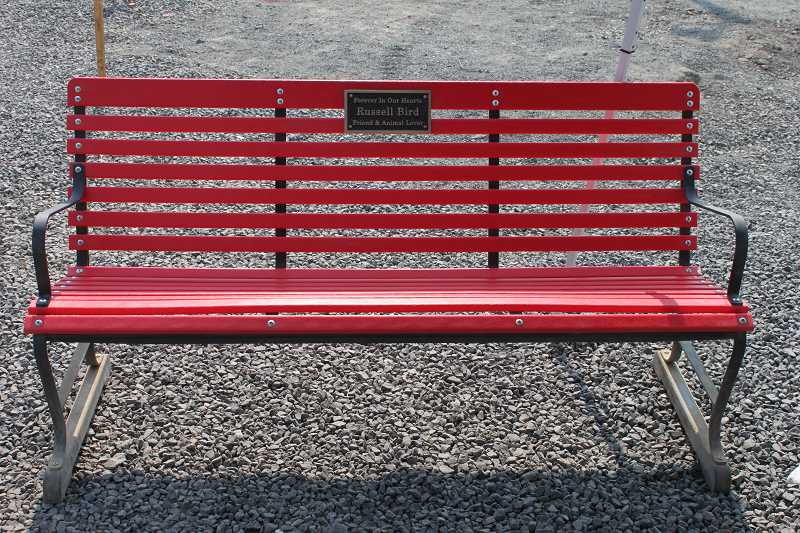 JENNIFFER GRANT - A bench honoring the late Russell Bird, a KTVZ meteorologist who did several stories on Three Rivers Humane Society's plans to build a new facility, sits outside the current office.