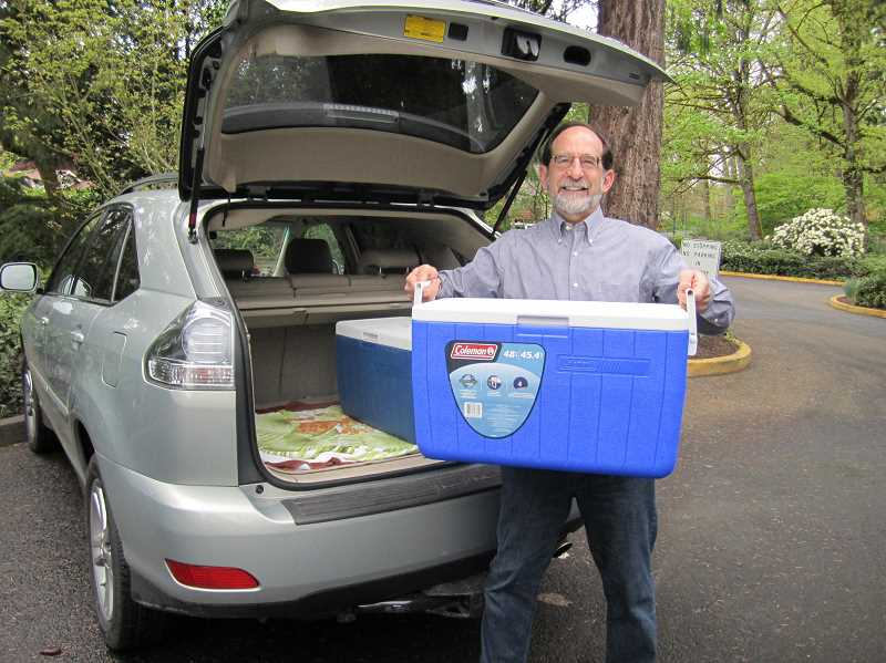 SUBMITTED PHOTO  - Andy Harris, a longtime volunteer driver and emeritus Lake Oswego Meals on Wheels board member, loads his car trunk with meals. The LOMOW program is starting its annual fundraising efforts this fall.