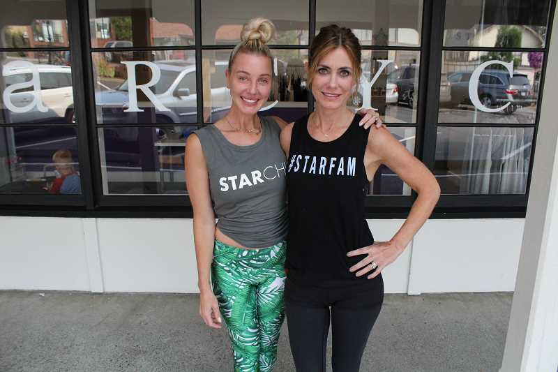 REVIEW PHOTO: SAM STITES - Erin Moone (left) and Dionne Del Carlo pose in front of StarCycles first location in downtown Lake Oswego.