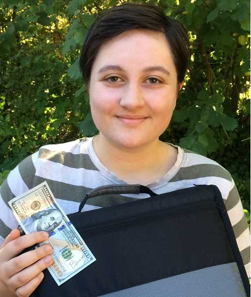 SUBMITTED PHOTO: AMARA MCCARTHY - Lake Oswego High School student Ari Vest beams with her 'Benny Bill' and new binder.