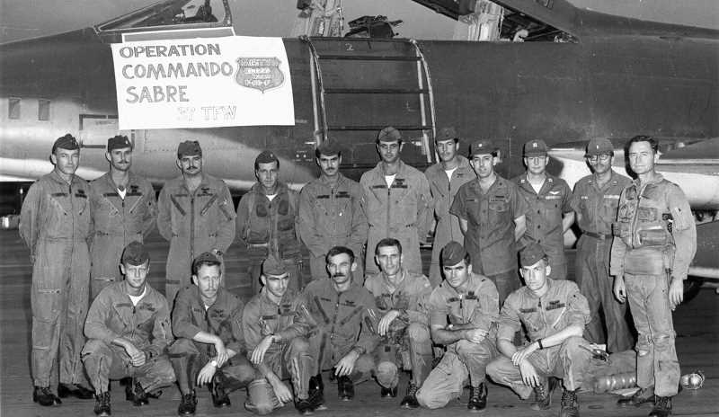 SUBMITTED PHOTO: UNITED STATES AIR FORCE - Gen. Tony McPeak (second from left standing) is shown here in Vietnam during Operation Commando Sabre, of which he served as the 10th commander of the forward air controllers in South Vietnam.