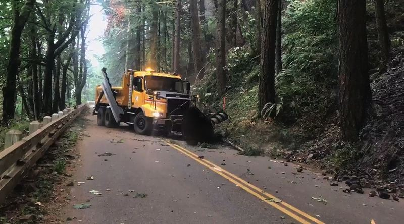 COURTESY PHOTO: ODOT - ODOT crews cleared brush and damaged trees from the Historic Columbia River Highway this week. Damaged trees and rocks could pose a danger to drivers, and ODOT is working to clear problems before reopening a 45-mile stretch of I-84 that has been closed since Monday.