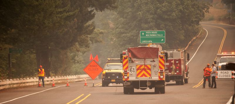 OUTLOOK PHOTO: JOSH KULLA - Firefighters and Mutlnomah County Road crews monitor the road closure on the Historic Columbia River Highway where the evacuation level changes to Level 3 — 'Go!'